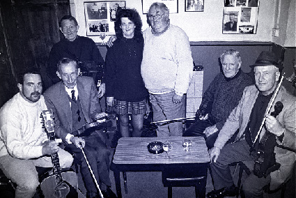 "at the very first POKfest--From L to R: Tim Keily, Jerry McCarthy, Johnny O'Leary, Mary Jones (one of the primary organisers of the event), Dan O'Connor, Paddy Cronin, and Denis ""The Hat"" McMahon"