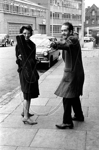 Julia and John Clifford after a Sunday lunchtime session in the Oxford Arms, Camden Town, London, 1963