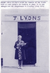 Julia Clifford poses in front of Lyons' with the fiddle that was kept there for Padraig O'Keeffe