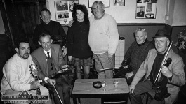 The well-known Knocknagree publican, Dan O'Connell pictured centre with Mary Jones at the first session of the inaugural Patrick O'Keeffe Traditional Music Festival which took place at The Rambling House, Castleisland in October 1993. Pictured before the music began were: proprietor Mary Jones with, from left: Tim Kiely, Jerry McCarthy, Johnny O'Leary, Dan O'Connell, Paddy Cronin and Denis McMahon. ©Photograph: John Reidy 22-10-1993