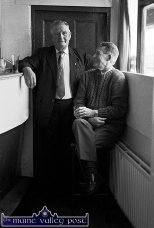 Mikey Duggan (left) pictured with the late Johnny O'Leary in Tom Fleming's bar in Scartaglin on July 25-1991. The Scart fiddle player is to be honoured at Sunday night's concert. Photo by John Reidy